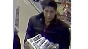 Undated photo released on October 24 by Britain's Blackpool Police, showing an alleged thief bearing a striking resemblance to Ross Geller, the character played by actor David Schwimmer on the TV show