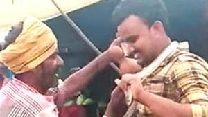 Screen grab of an Andhra man whose attempt for a selfie with a cobra around his neck proved fatal for him (HT)(HT)