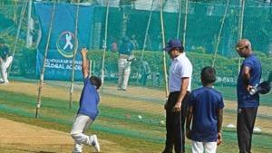 Sachin Tendulkar and Vinod Kambli, train children at Tendulkar Middlesex global academy in Pune.(HT Photo)