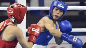 Mary Kom (in Blue) in a bout against Kazakhstan's Aigerim Kassenayeva (in Red), in Women's 45-48 kg category.(Sanjeev Verma/HT PHOTO)
