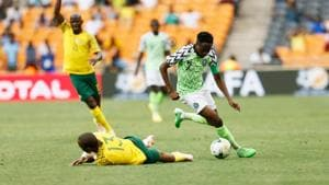 South Africa's Tiyani Mabunda (L) is tackled by Nigeria's captain Ahmed Musa during the African Cup of Nations qualifier match between South Africa and Nigeria on November 17, 2018 at Soccer City Stadium in Johannesburg, South Africa(AFP)
