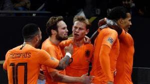 Netherlands' defender Virgil van Dijk celebrates with teammates after scoring against Germany.(AFP)