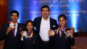 Minister of State for Youth Affairs & Sports, Rajyavardhan Singh Rathore with shooters Saurabh Chaudhury, Mehuli Ghosh, and Manu Bhaker during the winners of the Summer Youth Olympics 2018 felicitation ceremony, in New Delhi(PTI)