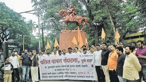 Members of patit pawan sanghatana protest against compulsion on wearing helmets while riding a two wheeler at Balgandharva Rang Mandir chowk on Wednesday.(HT Photo)