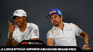 McLaren's Spanish driver Fernando Alonso (R) and Mercedes' British driver Lewis Hamilton speak as they attend the drivers' press conference ahead of the Abu Dhabi Formula One Grand Prix at the Yas Marina circuit on November 22, 2018.(AFP)
