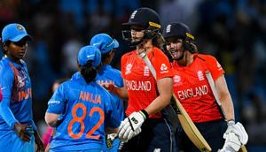 India players congratulate Amy Jones (C) and Nat Sciver (R) of England for winning the ICC Women's World T20 2nd semi-final match between England and India at Sir Vivian Richards Cricket Ground(AFP/Getty Images)
