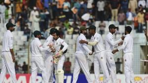 Bangladeshi cricketers celebrate their win at the end of the third day of the first Test cricket on match between Bangladesh and West Indies at the Zahur Ahmed Chowdhury Stadium in Chittagong.(AFP)