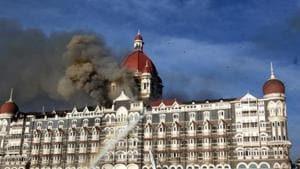 26/11 - Mumbai Under Terror Attack - Firing - Fire at Taj Hotel - Fire brigade officers fighting with fire at Taj hotel.(Hindustan Times)