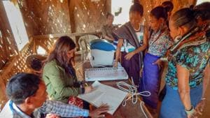 Electoral officials demonstrate how to use an Electronic Voting Machine (EVM) at Kasko Reang refugee camp, in Panisagar sub-division of Mizoram Sunday, Nov. 25, 2018. Assembly election in Mizroram is slated for November 28, 2018.(PTI)