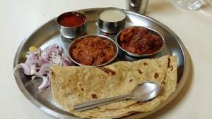 The Mutton Thali at Padma Guest House, Kolhapur. No thali here is complete without the Tambda Rassa (an intensely stormy red gravy with a tarri floating on top) and Pandhra Rassa (a delicately spiced, white, buttery gravy of coconut and garam masala).