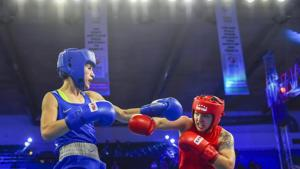 New Delhi: Stanimira Petrova (Blue) of Bulgaria fights with Rianna Rios of USA in womens' 57 kg category bout during AIBA Women's World Boxing Championships at IG Stadium in New Delhi, Saturday, Nov. 17, 2018(PTI)