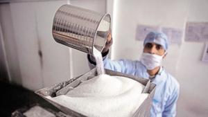 A worker fills sugar into a machine making sugar cubes at a sugar making unit in Ghaziabad, Uttar Pradesh. (Image for representation)(Bloomberg file photo)