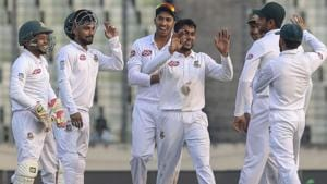 Bangladesh's Mehedi Miraz (C) celebrate with teammates after the dismissal of West Indies Shai Hope.(AFP)