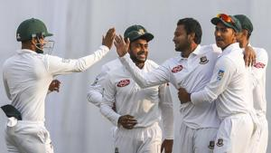 Bangladesh's Shakib Al Hasan celebrates with his teammates after the dismissal of West Indies' Kraigg Brathwaite during the second day of the second Test cricket match between Bangladesh and West Indies in Dhaka.(AFP)