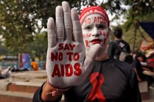 A man poses as he displays his hand and face painted with messages during an HIV/AIDS awareness campaign on the eve of World AIDS Day.(PICTURE FOR REPRESENTATIONAL PURPOSES ONLY)