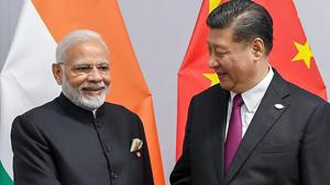 Prime Minister Narendra Modi shakes hands with Chinese President Xi Jinping on the sidelines of G-20 summit, in Buenos Aires, Friday, Nov. 30, 2018.(PTI)