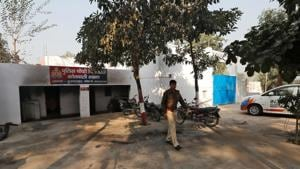 A police officer walks in the premises of a police station that was partially damaged by a mob during a protest on Monday in Chingrawti village of Bulandshahr district in Uttar Pradesh.(REUTERS)