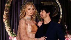 Game of Thrones Sophie Turner and singer Joe Jonas pose during the wedding reception of Priyanka Chopra and American singer Nick Jonas in New Delhi on December 4, 2018.(REUTERS)