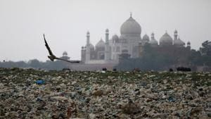 FILE PHOTO: GGarbage is seen on the polluted banks of the river Yamuna near the historic Taj Mahal in Agra, May 19(REUTERS)