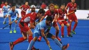 India's Manpreet Singh (C) tries to dribble past Belgium players during the field hockey group stage match between India and Belgium at the 2018 Hockey World in Bhubaneswar on December 2, 2018)(AFP)