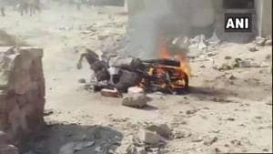 A motorcycle burning after a violent clash between workers of two different parties at a polling booth in Rajasthan's Fatehpur town during voting for the assembly elections (ANI/Twitter)(ANI/Twitter)
