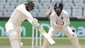 Australia's Usman Khawaja plays at the ball as India's Rishabh Pant, right, watches.(AP)