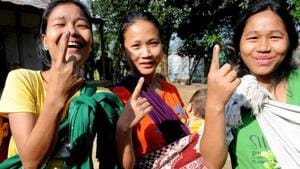 Young-girls-show-their-marked-fingers-after-casting-votes-for-Lok-Sabha-polls-at-a-polling-station-in-Aizawl-Mizoram(PTI)