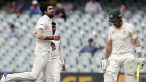 India's Ishant Sharma, left, celebrates after dismissing Australia's Tim Paine, right, during the first cricket test between Australia and India in Adelaide.(AP)