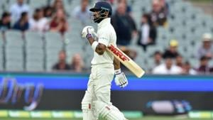 India's Virat Kohli walks after Australia took his wicket during day three of the first Test cricket match at the Adelaide Oval.(AFP)