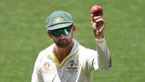 Australia's Nathan Lyon shows the ball as he leaves the field following his 6 wicket haul on day four of the first test match between Australia and India at the Adelaide Oval in Adelaide.(REUTERS)
