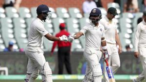 India's Ajinkya Rahane, right, and Cheteshwar Pujara walk out to bat on day four of the first Test between Australia and India.(AP)
