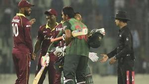 Bangladesh cricketer Mushfiqur Rahim (2R) hugs his teammate Mohammad Mahmudullah (3R) after winning the first One Day International (ODI) between Bangladesh and West Indies at the Sher-e-Bangla National Cricket Stadium.(AFP)