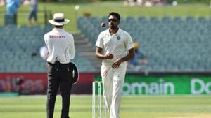 India's spin bowler Ravichandran Ashwin (R) prepares to bowl against Australia during day four of the first Test cricket match at the Adelaide Oval.(AFP)