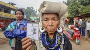 Mizoram elections 2018: A Bru tribal woman shows her identity card. Counting of votes for Mizoram and four other states will take place on Tuesday.(PTI file photo)