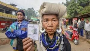 Mizoram exit polls 2018: Kanhmun: A Bru tribal woman shows her identity card as she waits to cast her vote at a polling station for the state Assembly elections, at Kanhmun, Mizoram.(PTI)