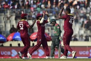 West Indies cricketer Oshane Thomas (R) celebrates with his teammates after the dismissal of the Bangladesh cricketer Mushfiqur Rahim (2R) during the second One Day International (ODI) between Bangladesh and West Indies.(AFP)