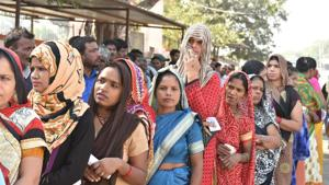 Voters stand in a queue to cast their votes, at North TT Nagar, in Bhopal, India, on Wednesday, November 28, 2018.(Mujeeb Faruqui/HT Photo)