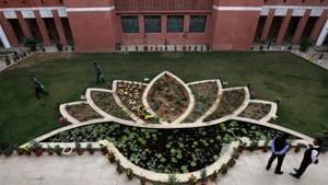 People walk inside the premises of India's ruling Bharatiya Janata Party (BJP) headquarters in New Delhi.(REUTERS)