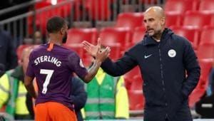 Manchester City manager Pep Guardiola celebrates with Raheem Sterling after the match(Action Images via Reuters)