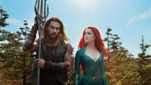 This image released by Warner Bros. Pictures shows Jason Momoa, left, and Amber Heard in a scene from Aquaman.(AP)