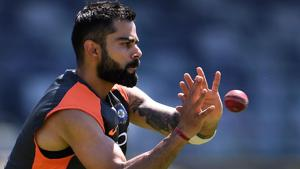 India's cricket captain Virat Kohli takes a catch during a training session in Perth on December 12, 2018. - India take on Australia in the second cricket Test match starting on 14 December in Perth.(AFP)