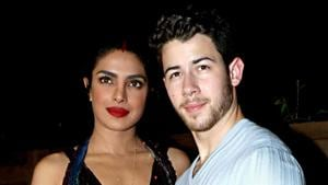 Priyanka Chopra and husband Nick Jonas pose for photos during the Bumble dating app launch, in Mumbai.(PTI)