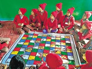 Teachers at the Primary School Perai are using the game to motivate students to be successful in life by climbing the simple ladder of hard work, without worrying too much about the hurdles -- represented by snakes.(HT)