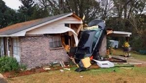 The scary photo shows the car almost upright against a wall of the house.(Montgomery Fire/Rescue/Facebook)