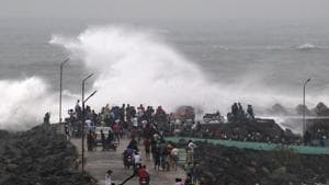 Indian residents walk along a breakwater at Kasimedu fishing harbour as cyclone Phethai approaches the eastern Indian coast, in Chennai on December 16, 2018. - Cyclone Phethai made landfall on the Andhra Pradesh coast on December 17. (Photo by ARUN SANKAR / AFP)(AFP)