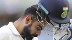 India's Virat Kohli removes his helmet as he walks off after being dismissed during play in the second cricket test between Australia and India in Perth, Australia, Monday, Dec. 17, 2018. (AP Photo/Trevor Collens)(AP)