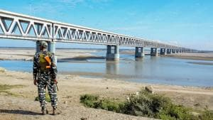A security personnel stands guard at Bogibell Bridge in Dibrugarh. Prime Minister Narendra Modi will inaugurate on December 25 the Bogibeel Bridge, India's longest rail-road bridge, connecting the north and south banks of the Brahmaputra, falling in the eastern part of Assam and Arunachal Pradesh.(PTI)