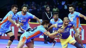 Chennai: Bengal Warriors (Blue Orange) players in action against Tamil Thalaivas during their Pro Kabaddi league match.(AP)
