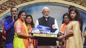 Prime Minister Narendra Modi being felicitated by BJP women's wing leaders during their National Convention, in Ahmedabad on December 22.(PTI Photo)