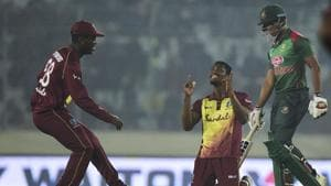 West Indies cricketer Keemo Paul (C) celebrates after the dismissal of Bangladeshi cricketer Mohammad Saifuddin (R) during the third Twenty20 (T20) cricket match(AFP)